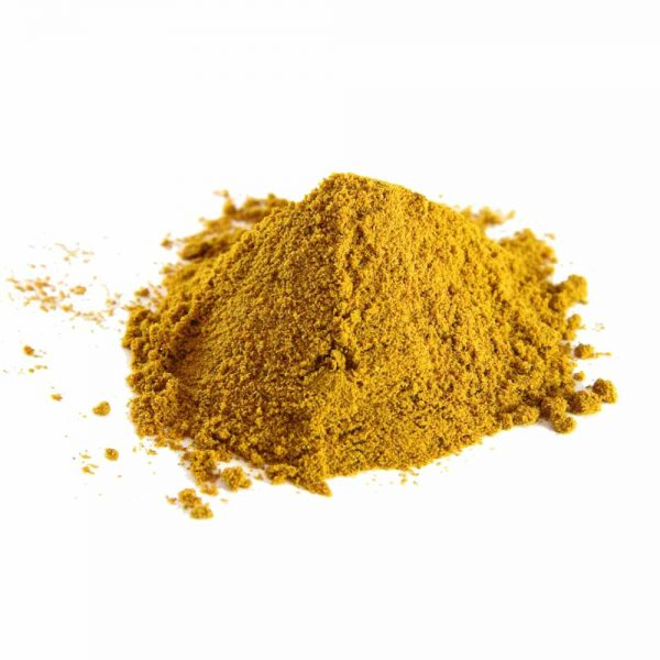pile of curry powder on white background
